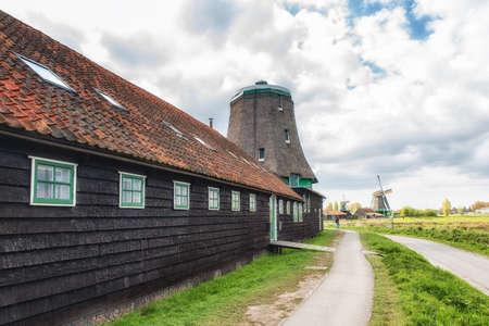 De Os is an oil windmill in the Zaanse Schans, Zaanstad. Stock Photo