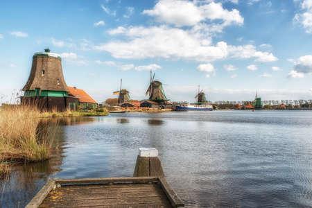 zaan: Zaanse Schans, the Netherlands - April 19, 2017: windmills at Zaanse Schans, an industrial and national Dutch heritage site and famous tourist destination in the municipality of Zaandam, the Netherlands. Zaanse Schans is located on the river Zaan, from wh