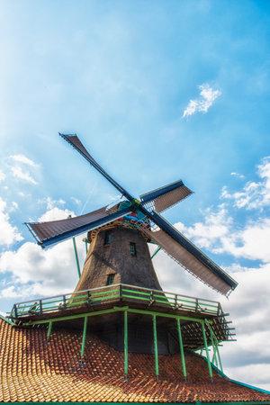 zaan: Paint Mill De Kat in Zaanse Schans,Traditional Dutch old wooden windmill in Zaanse Schans - museum village in Zaandam. The Netherlands. Editorial