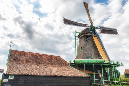 Oil mill de bonte hen,Zaanse Schans, Traditional Dutch old wooden windmill in Zaanse Schans - museum village in Zaandam. The Netherlands.