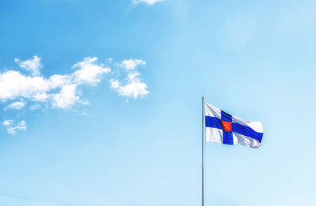 Flag of Finland against a blue sky Stock Photo