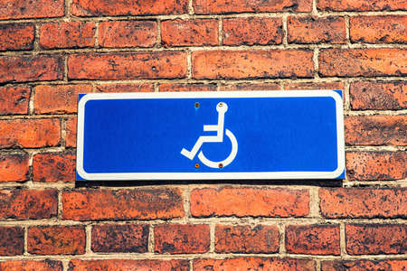 building feature: A Blue Wheelchair Sign agains a blue sky