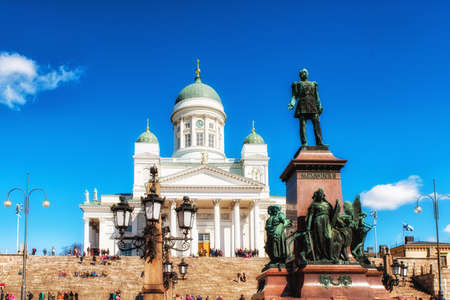 st nicholas cathedral: Helsinki, Finland - May 12, 2017: Lutheran Cathedral St Nicholas Church and a monument to Alexander II on the Senatorial area in Helsinki, Finland Editorial