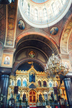 Helsinki, Finland - May 12, 2017: The Iconostasis of the Uspenski Cathedral in Helsinki, Finland. The cathedral is an Eastern Orthodox cathedral dedicated to the Dormition of the Theotokos (the Virgin Mary). It is the main cathedral of Finnish Orthodox Ch