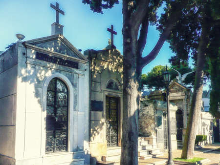 peron: Buenos Aires, Argentina - June 03, 2016: Beautiful and ornate tombs at the Recoleta Cemetery. Many famous argentinians are buried here. Among them Eva Peron Duarte. The cemetery has become a tourist atraction.