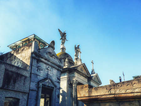 Buenos Aires, Argentina - June 03, 2016: Beautiful and ornate tombs at the Recoleta Cemetery. Many famous argentinians are buried here. Among them Eva Peron Duarte. The cemetery has become a tourist atraction.