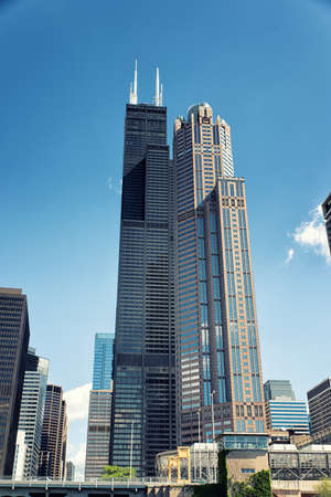 The Willis Tower, built as and still commonly referred to as the Sears Tower, is a 108-story, 1,450-foot (442.1 m) skyscraper in Chicago, Illinois, United States. Stock Photo