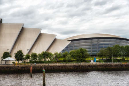 Glasgow, Scotland, UK - July 07, 2017: The SEC Armadillo and SSE Hydro Arena make up two parts of the Scottish Event Campus (SEC) on the banks of the River Clyde. Редакционное
