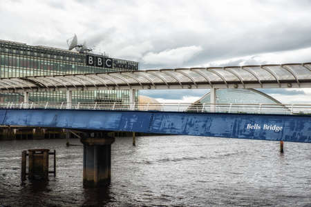 Glasgow, UK - July 07, 2017: The BBC Scotland headquarters offices and studios and Science Centre buildings viewed from the Bells Bridge over the River Clyde at Pacific Quay in Glasgow, Scotland.