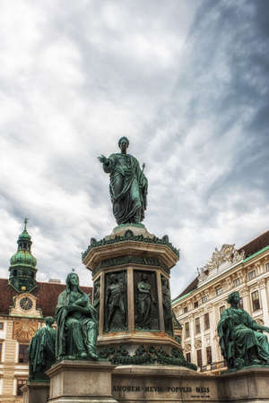 Vienna, Austria - July 09: Hofburg, the former imperial winter palace in the centre of Vienna. Bronze statue of Francis I dressed as a Roman emperor, by Pompeo Marchesi, with Amalienburg, Vienna (Wien), Austria (Osterreich)