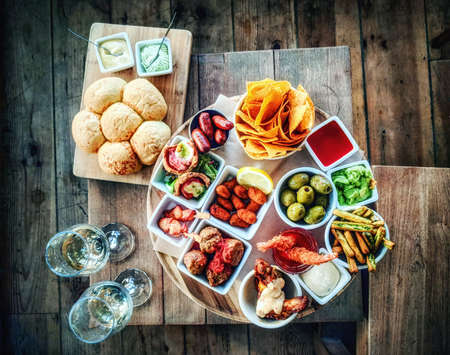 Delicious tapas selection on wooden table from above Zdjęcie Seryjne