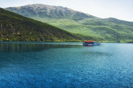 pleasure boat taking passengers across Lake Ohrid from Ohrid town to Sveti Naum monastery complex, Macedonia
