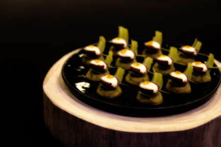 Small canapes in the shape of open eggs