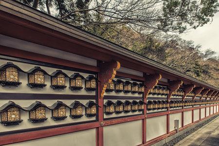 Narita, ChibaJapan - March 17, 2018: Row of lights on the wall surrounding a pagoda at Narita-san Shinshoji temple in Narita, Japan. The temple belongs to the Chisan sect of Shingon Buddhism Editöryel
