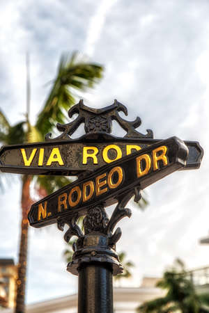 Los Angeles, CA, USA - February 02, 2018: Rodeo Drive sign with palm trees in Beverly Hills