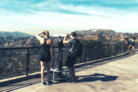 Los Angeles, CA, USA - February 02, 2018: Tourists visiting Griffith park observatory looking at Hollywood Sign in the distance. Sajtókép