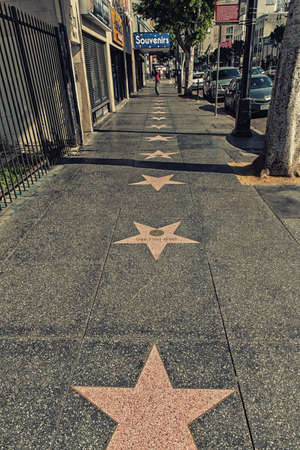 Los Angeles, CA, USA - February 02, 2018:  Walk of Fame at sunset on Hollywood Boulevard. In 1958, the Hollywood Walk of Fame was created as a tribute to artists working in the entertainment industry.