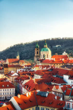 prague, Czech Republic - April 04: Saint Nicolas church and rooftops of Lesser Town Editorial