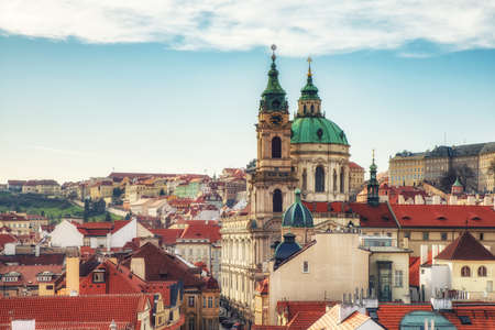 prague, Czech Republic - April 04: View of St Nicholas Church at Mala Strana (Kostel sv. Mikulase) Cathedral in old town and the main street to the Prague Castle from the top of the Lesser Tower Redactioneel