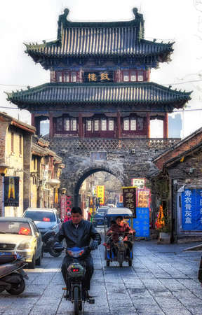 Luoyang, Hernan, China - December 25 ,2017 : the busy street of old town Luoyang. The old town of Luoyang, a popular local residents and tourist destination. Lined with old fashion retail shops and eateries food services and restaurants. A busy commercial