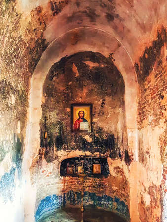 Uplistsikhe, Georgia  - April 13, 2017: iconostasis in Christian Basilica in ancient rock-hewn town called Uplistsikhe in Georgia