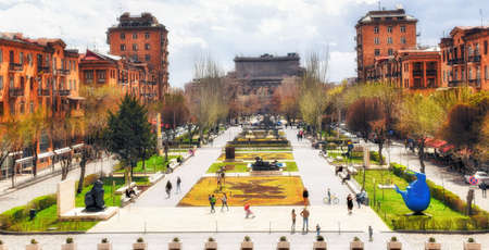 Yerevan, Armenia - 09 April, 2017: People enjoy a warm autumn evening at the Cascade, a giant stairway in Yerevan, Armenia. It was designed by architects Jim Torosyan, Aslan Mkhitaryan, Sargis Gurzadyan and completed in 1980 when Armenia was part of the S