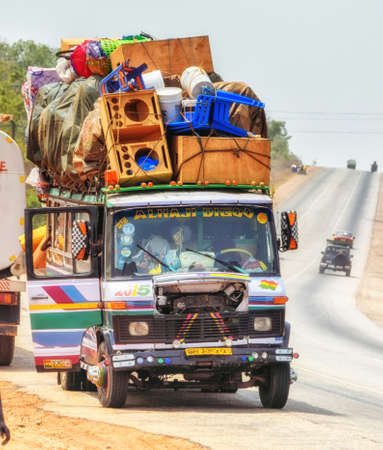 Elmina, Ghana - February 27, 2016: An Overloaded lorry in Ghana, north of Accra. Editorial