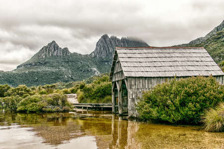 Tasmania's Cradle Mountain with Dove Lake and historic boat shed