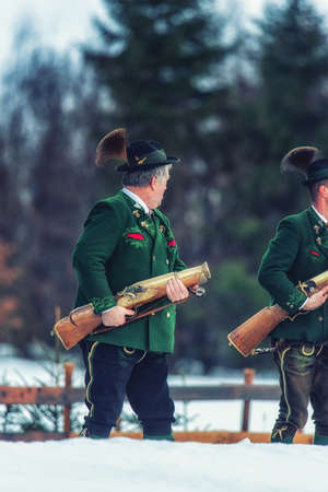 Bad Ischl, Austria  31 December 2017: Celebratory gunfire performed by the shooters from the Association of the D´Ischler marksmansguild. Editorial