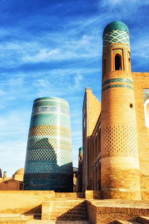 Khiva, Uzbekistan - October 13, 2015: The unique and unfinished Kalta Minor Minaret, covered with bright blue tiles, became the symbol of Khiva.