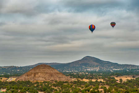Hot Balloons at the Pyramids of the Sun and Moon on the Avenue of the Dead, Teotihuacan ancient historic cultural city, old ruins of Aztec civilization, Mexico,South America
