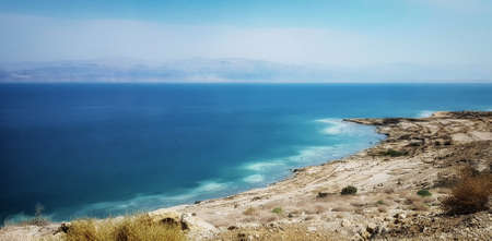 The Dead Sea is a salt lake bordered by Jordan to the east and Israel and the West Bank to the west.