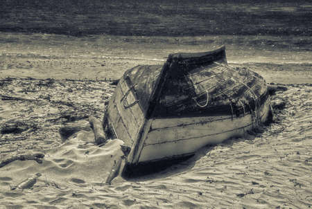 Black and White picture of Fishing boat on the beach