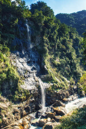 The Wulai Waterfall is possibly the best known waterfall in Taiwan besides the Shifen Waterfall.the waterfall featured an 80m drop right across from the Atayal aboriginal-themed town of Wulai. 版權商用圖片