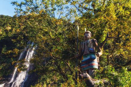 Taiwan. Wulai Native Village, Statue of hunter with his dog. Фото со стока - 123761649