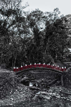 black and white forest with red bridge, Wulai, Taiwan.