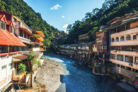 River in the center of the Wulai village, Taiwan. It is a popular spa near Taipei. Many tourists come here to take a bath in warm springs. Banco de Imagens