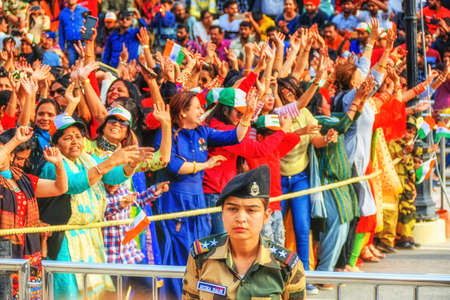 Wagah, India - March 13, 2019: Spectators at the daily India-Pakistan border ceremony of lowering of the flags