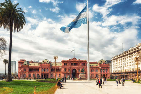 Buenos Aires, Argentina -  29 August 2019: A view of Casa Rosada, or Pink House, the office of President of Argentina. with landmark Plaza de Mayo, location of many historic and political events.