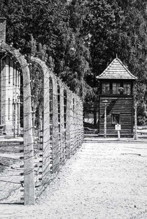 The guards watch tower and fence of barbed wire, Auschwitz - Birkenau concentration camp, Poland 에디토리얼