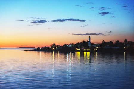 sunset in Colonia del Sacramento, Uruguay, with lighthouse above Rio de la Plata