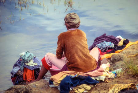 A woman washing clothes in Ramonafama river in Park of Ramonafama, Fianarantsoa, Madagascar, Africa
