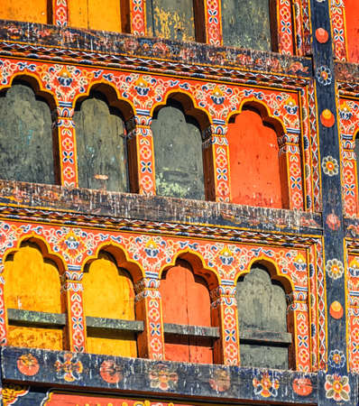 Architectural detail of the richly carved, painted wood in Paro Dzong.
