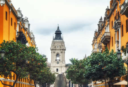 stunning colonial architecture clustered around the city's Plaza de Armas with in the backdrop the Basilica Cathedral bell tower of Lima, Peru