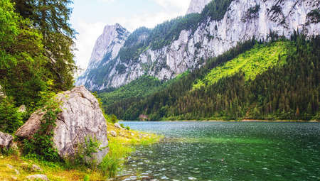 The Lake Gosau is a small mountain lake, embedded in beautiful nature with a view of the Dachstein Mountains.