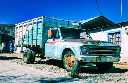 An old truck parked outside in the small town of Belen, Chile