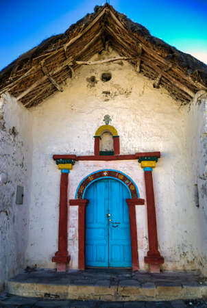 Exterior of the beautiful Parinacota village church located circa Putre, Chile. Parinacota church was built in the 17th century of stone and clay, located 4,400 meters AMSL in Lauca National Park, Chile. Фото со стока