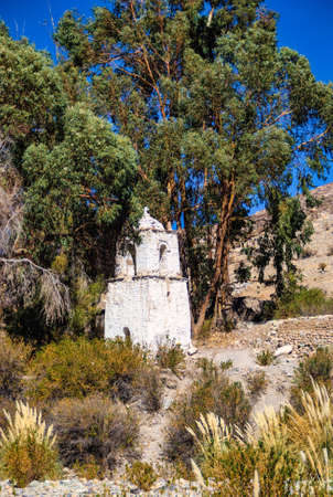 Bell tower in the village of Belen in the Andean foothills Chile. Фото со стока