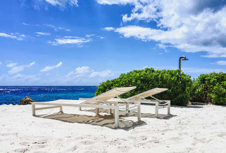 Sunbeds on the beach of the Caribbean isle Curacao in the Netherlands Antilles