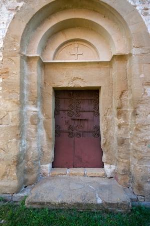 Church door of sant pere de lligordá.11th-12th century.Catalonia.Spain photo